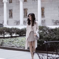 Get this look: http://lb.nu/look/8619629  More looks by Christie Ashley: http://lb.nu/christieashley  Items in this look:  Chain Bag, Club Monaco Trench, Aritzia Skirt, Public Desire Sock Boots, Aritzia Marquis Cami   #chic #romantic #street