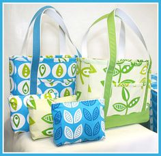 "This tote is a 14"" x 11"" x 3-1/2"" deep tote with one exterior pocket and two interior pockets- one zippered. It is designed for hard wear with two layers of fabric at the bottom and straps that won't rip off. The totes above are made from fabrics in the Modern Flora Collection. Get the Free J. Caroline Tote Bag Tutorial  Advertisement"