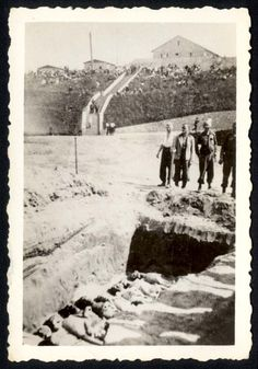 Mauthausen, Austria, German prisoners burying bodies, after the liberation. German prisoners burying bodies in mass graves under the supervision of American soldiers.
