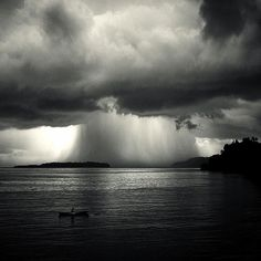 Beautiful black and white landscape photography showing rain clouds over the sea. /// 'Waterfall' Bandaneira, East Indonesia, photographed by Hengki Koentjoro Black White Photos, Black And White Photography, Fine Art Photography, Landscape Photography, Ethereal Photography, Underwater Photography, Photography Women, Vintage Photography, Amazing Photography
