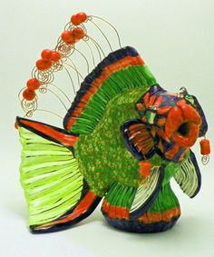 Large Crescent Wrasse Fish Teapot, with handmade ceramic beads and earrings. Rhinestones embedded in eyelids and high temp wire eyelashes.  http://www.facebook.com/pages/Judy-B-Freeman-Pottery/139787001018
