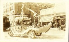 1913 Ak-Sar-Ben Parade: Miss Hoffman's floral float passing 25th & Farnam Streets. #Omaha