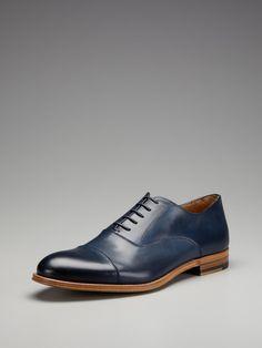 Antonio Maurizi. I'm really digging these in the burnished blue and love the profile.