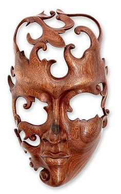 """By Wayan Rendah, this enigmatic mask is a song of love. Like swirling ribbons, suar wood tendrils lightly caress the face – samanea saman – a lover's face with openings carved in the eyes. """"Her eyes, the window of her heart, are on him... with him in her thoughts in every moment,"""" the artisan muses."""