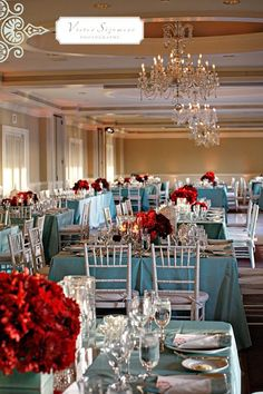 Robin's egg blue tablecloths accented with red florals