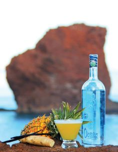 A @Four Seasons Resorts Lanai locally sourced cocktail in front of Sweetheart Rock? A honeymoon moment doesn't get much more heavenly than this.