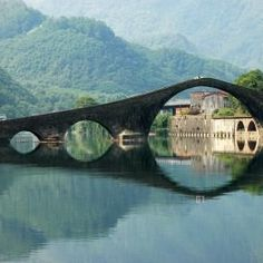 """Devil's Bridge, Lucca, Italy.  Ponte della Maddalena (Italian: """"Bridge of Mary Magdalene"""") is a bridge crossing the Serchio river near the town of Borgo a Mozzano in the Italian province of Lucca. One of numerous medieval bridges known as Ponte del Diavolo, the """"Bridge of the Devil"""", it was a vital river crossing on the Via Francigena, an early medieval road to Rome for those coming from France that was an important medieval pilgrimage route."""