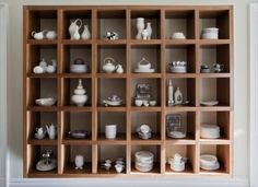 Show off your collection. A cube shelf along one wall is an excellent way to store and display favorite kitchenware.