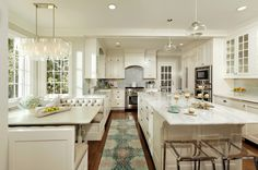 Amazing glam kitchen with touches of turquoise {via House of Turquoise: Virginia Kitchens + Harry Braswell Inc.}