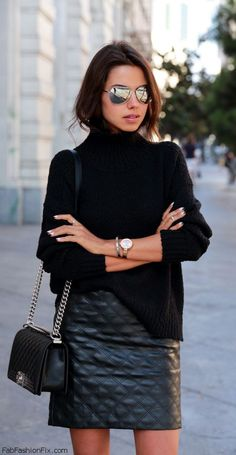 Cozy black turtleneck sweater, leather mini skirt and Chanel Boy bag for chic street style.