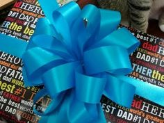 Easy To Make Gift Bows! I can't believe how fast and easy this is!! #GiftBows #HowToMakeBows