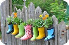 Rain boot flower pots????  What a CUTE idea!  Wish I had a pickett fence.