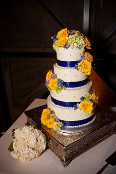 Yellow and blue wedding cake|Photo by: rootweddings.com