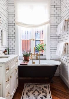 Subway Tiles and Brass Fixtures