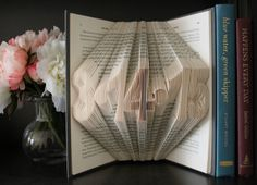 A unique bridal shower gift! Or a stunning wedding gift for the bride and groom. Custom hand-folded book art is guaranteed to WOW!