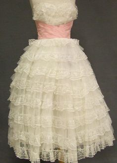 Ivory frilly dress   from: vintageous