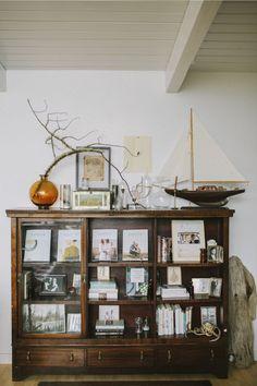 Eclectic nautical bookshelf style interior decor