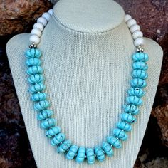 The Blue Skies, White Clouds handmade necklace shown on a jewelry bust - Southwest inspired gift idea.