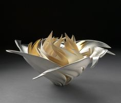 JENNIFER MCCURDY...I believe this may be clay, but I love the form.  It would read wonderfully in metals.