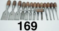 SET OF EVERLASTING CHISELS. Stanley No. 40s. 13 in sizes 1/8, 1/4, 3/8, 1/2, 9/16, 5/8, 3/4, 7/8, 1, 1-1/4, 1-1/2, 1-3/4, and 2 inches. Plus a salesman's sample cutaway version that shows how the Everlasting chisels were made.