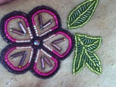 Beaded floral design on Moose skin for the tongue part of Athabascan Slippers made by Valda Akpik