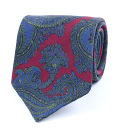 Red Crayford Paisley Print Twill Madder Silk Tie A classic Drake's paisley design writ large and printed in a selection of seasonal colours. The traditional Madder silk printing process gives this tie it's rich colour and wonderfully dusty handle that will only improve with age.  • 100% Silk • Handrolled Blades • Self Loop/Keeper • Handmade in London, England