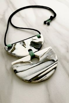 Black and white marbled statement necklace 100% Handmade Marbled and molded using polymer clay Black rope cord Rust green detail thread nonadjustable
