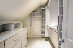Making the most of an attic bedroom closet space.
