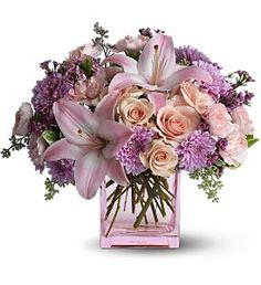 Possibly Pink  The delicately hued bouquet includes lavender cushion spray chrysanthemums, pink asiatic lilies, peach spray roses, pink miniature carnations and lavender waxflower accented with fresh greenery.