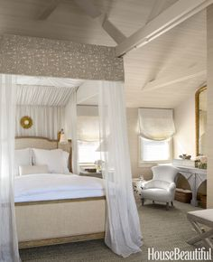 Designer Benjamin Dhong wanted the master bedroom in a California house to feel like an elegant tree house. Restoration Hardware's Josephine bed is curtained with Sahco's Lara linen. Valance, Classic Cloth's Nottingham II cut velvet.   - HouseBeautiful.com