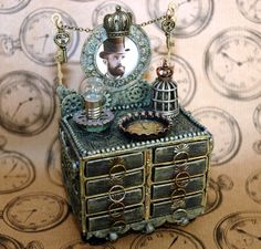 Oh my goodness ... Candy Colwell has done it again.  Seriously ... go visit her blog to see all the amazing details on this piece. CREATIVITY IS CONTAGIOUS: GUEST DESIGNER STEAMPUNK MATCHBOX DRESSER & TUTORIAL