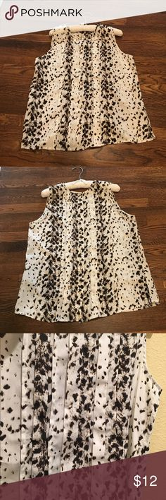 FLASH SALE Animal print sleeveless top Airy sleeveless top.  Says Medium, fits like a large.  Pleats in front, buttons up the back... Can really just pull over your head Tops