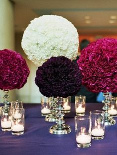 Love the flower ball, with mason jars and wood covered candle holders for center pieces