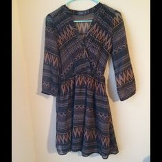 Tribal Print Mini Dress Adorable v-neck tribal print mini dress! Size XS but would easily fit a small! Feel free to make an offer! Dresses Mini