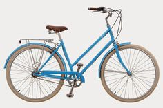 French blue bike with cream tires brown seat and grips