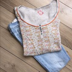 Free People Thermal Floral Print Shirt Sz Sm! Free people thermal long sleeved shirt Sz Sm. Worn but in good condition. Small orange flower print. Waffle knit material. Free People Tops Tees - Long Sleeve