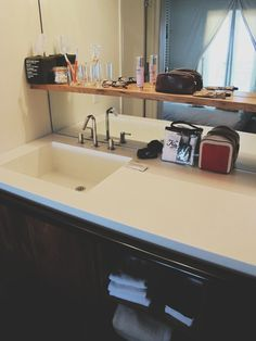 Updating a seventies bathroom a la ace hotel palm springs. White corian counter, simple wood shelf.