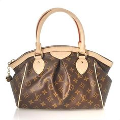 "A chic and roomy everyday Louis Vuitton handbag. Monogrammed canvas is trimmed in natural cowhide leather with dyed red edging, signature yellow top-stitching and goldtone brass hardware. A leather patch and padlock decorate the side, topped by rolled leather handles. Zip top opens to brown canvas lining with a flat pocket and a cell phone slot. Dimensions: 14""L x 5 1/2""W x 9""H; 5"" handle drop."