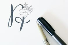 1. Lightly draw the basic form of the letter 2. Thicken downstrokes 3. Erase area you'd like to put the flower, and lightly draw in 4. Ink (I used a Micron pen - just make sure you use a pen that is waterproof)