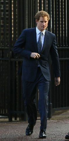 Britain's Prince Harry walk to Lancaster House to attend the Illegal Wildlife Trade Conference in London, 13.02.2014.