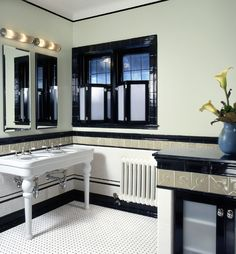 the mix of gray tiles with black and white