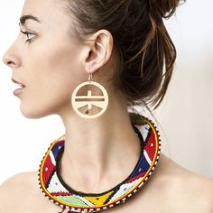 A Saturday sneak peek at our Photoshoot with featuring our 'Mmere' hanging earrings we think these would look amazing with your Ndebele knit set!