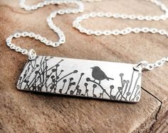 Hey, I found this really awesome Etsy listing at https://www.etsy.com/listing/62539033/bird-necklace-little-bird-in-the-tall