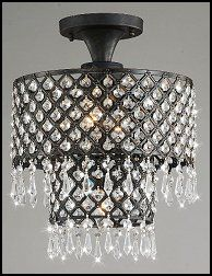 An antique bronze finish highlights this Melinda flush-mount chandelier. This 3-light fixture features crystal accents and an iron base.