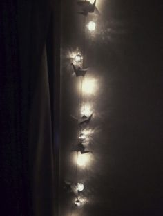 Origami cranes with string globe covered fairy lights