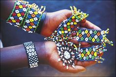 """Just a few examples of the kind of unique and colorful beadwork created by Zulu women in Johannesburg and elsewhere in South Africa.  The income from selling exquisite pieces like these often is used to support an entire family."" Johannesburg, South Africa photo of ""Gorgeous Jo'burg beadwork created by Zulu crafters"" by IgoUgo travel photographer, francelvr."