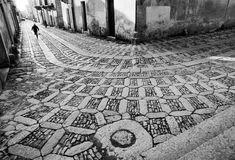 Ferdinando Scianna  ERICE, Sicily—Cobblestone streets, 1987.