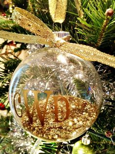 Vinyl monogram (or paint) onto a clear Christmas ornament. Fill halfway with glitter. Tie a ribbon bow.