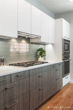 Built in hood. gray base cabinets. oven microwave . glass backsplash. divinedesignbuild.com