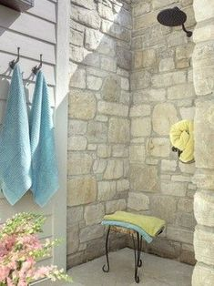 A sunny nook framed in stone + shower head = fabulous outdoor shower!